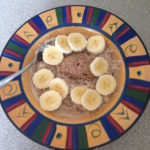 Coconut milk porridge topped with banana and almond butter 5