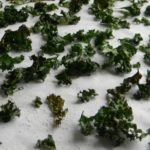 kale chips on a baking sheet