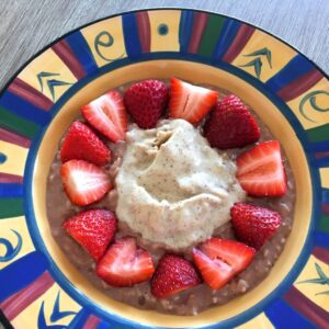Choc nut butter porridge with strawberries