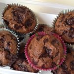 chocolate muffins stacked in a container