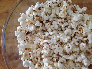 close up of popcorn in a glass bowl