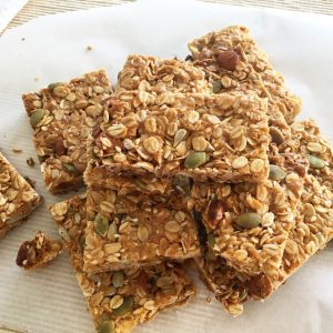 muesli bars stacked on a placemat