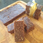 No bake chocolate energy bars on a chopping board, some tied with ribbon 2