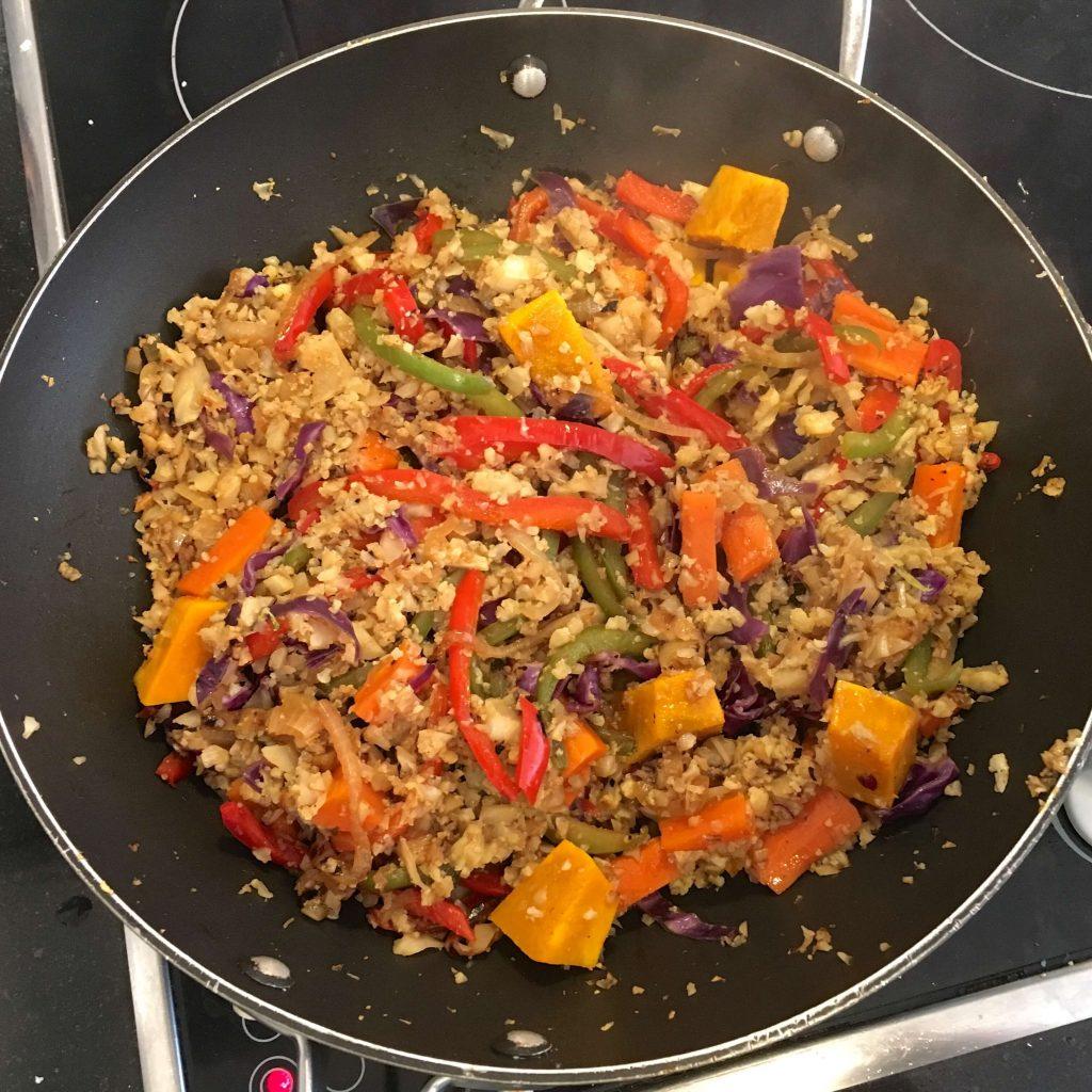 cauliflower fried rice in a wok