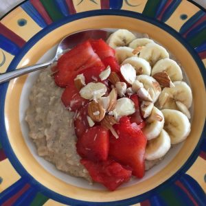 coconut milk porridge topped with strawberries and banana 2