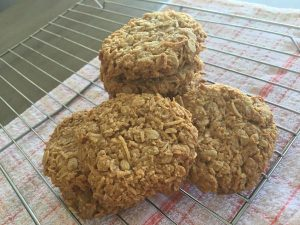 Anzac biscuits cooling on a rack