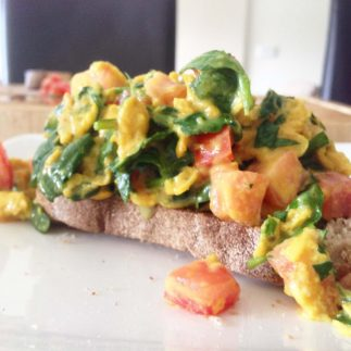 turmeric eggs on a slice of rye toast